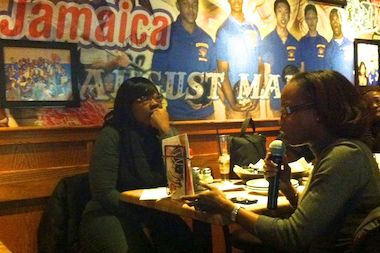 Residents participate in a discussion during a Community Conversations event at Applebee's in Jamaica.