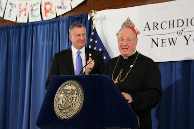 Cardinal Timothy Dolan and Mayor Bill de Blasio discussing universal pre-kindergarten expansion in the city during an event in the Bronx on March 6, 2014.
