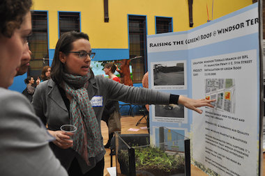 A budget delegate discusses a project from the 2014 participatory budgeting expo in Park Slope.