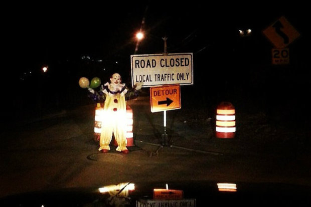 A mysterious clown holding balloons has been spotted around the streets of Staten Island.