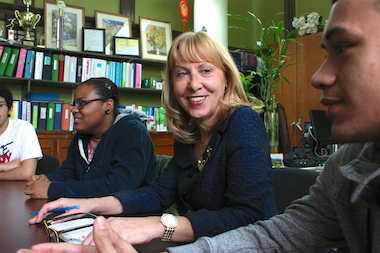 Elizabeth Collins, the principal of University Neighborhood High School, with some of her students.
