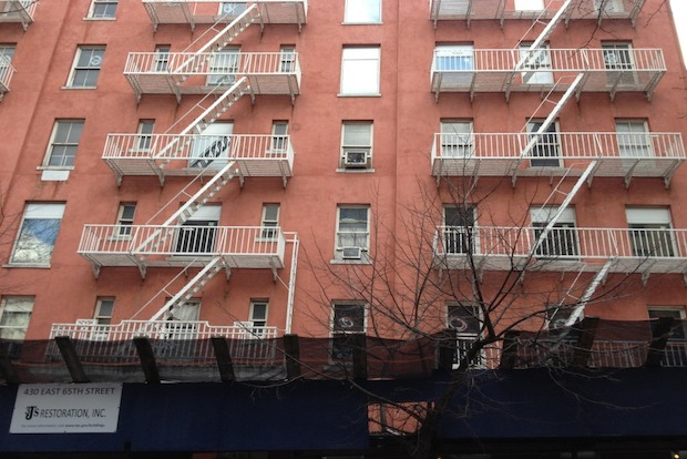 Tenants say that the owner has purposefully neglected their buildings during the three-year fight.