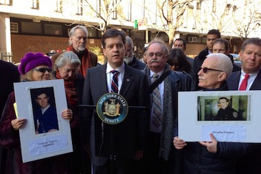 State Sen. Brad Hoylman stood with the families of the fallen auxiliary officers outside the 6th Precinct on March 14, 2014.