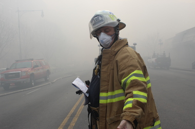 A firefighter at the scene of an East Harlem explosion and building collapse March 12, 2014.