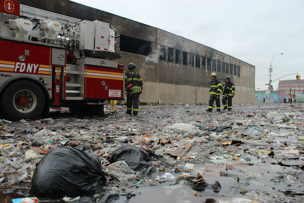 Firefighters spent more than 12 hours putting out a fire at a Brooklyn recycling plant Tuesday, March 18, 2014.