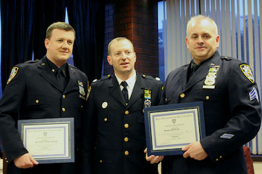 Officer Lucas Organista, Deputy Inspector Michael J. LiPetri and Sgt. Kieran Fox at a 79th Precinct Community Council Meeting, on March 27, 2014. Organista and Kieran were honored for arresting the 14-year-old accused of shooting and killing a man on the B14 bus in Bed-Stuy.