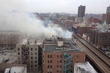An explosion on Park Avenue near East 116th Street sent up plumes of smoke visible from surrounding buildings on March 12, 2014.