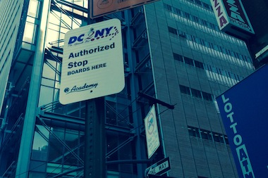A sign for the DC2NY spot next to the Port Authority Bus Terminal.