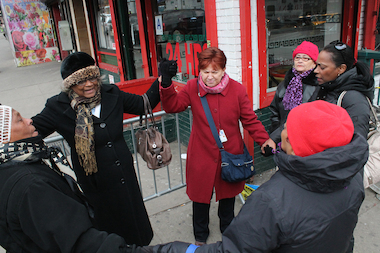 "Elsa Gonzalez, 57, a patient navigator at Mt. Sinai Hospital (red coat) gathered to pray with a group of other women near the site of the explosion that leveled two East Harlem apartment buildings Wednesday. They are just some of the East Harlem and Harlem residents who have gathered to help their neighbors in the wake of the tragedy by doing things like collecting money, clothing, food or offering temporary housing to the displaced. ""The community is hurting, we are hurting,"" said Gonzalez after the impromptu public praise session. ""Why not get together?"""
