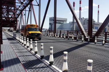 Residents say that the bridge's metal grating and gravel in bike lanes could cause an accident.
