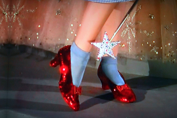 A woman stole Dorothy's ruby slippers from a Staten Island hotel, police said.