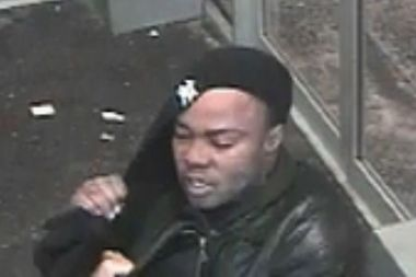 Police are looking for this man, who they say robbed a 40-year-old inside a Jackson Heights bank in January.