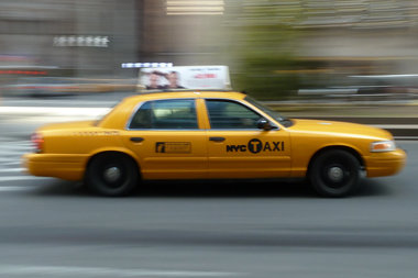 A cabbie was punched in the face after getting into an argument with a cyclist, police said.