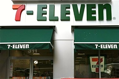 A 7-Eleven employee was attacked with a skateboard after a group of five shoplifters swiped candy from the 311 Broadway store, police said.
