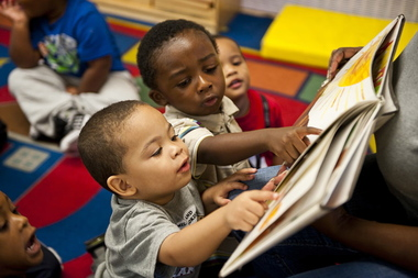 Children reading at Leggett Memorial Early Childhood Center where Shariah Bottex works. It is one of Union Settlement's seven East Harlem early education centers.