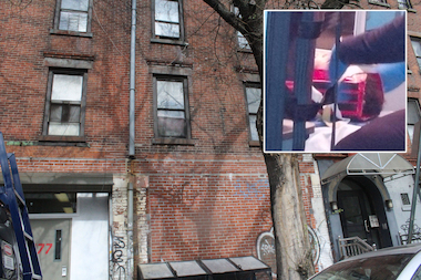 A toddler, inset, survived a fall from a third-floor apartment when he landed on a garbage enclosure at 177 Chrystie St. on Wednesday April 23, 2014, police said.