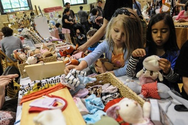 Kids check out goodies from last year's craft fair at P.S. 9 in Prospect Heights. The fair will be held for the sixth time Saturday, April 12, 2014.
