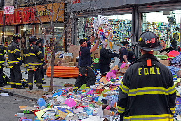 About seven people were injured when several shelving units tipped over onto customers, fire officials said.