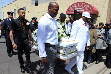 Pallbearers carried out the body of Jai'auni Tinglin at his funeral. Investigators found the response to the fire was delayed due to a flawed dispatch system.