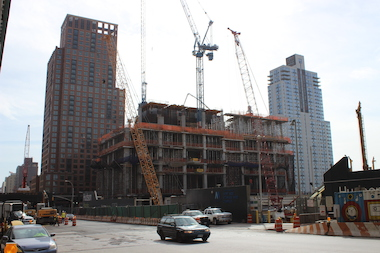 The under-construction Hudson Yards skyscraper, center, down the block from the Ohm building, right.