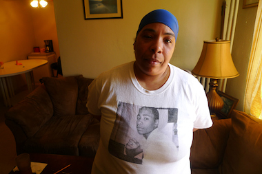 Karen Fludd filed a lawsuit against the NYPD and the MTA, accusing officers of assaulting her son after he fled during a fare-beating stop. Her son (pictured on her T-shirt) was left a quadriplegic and eventually died from his injuries.
