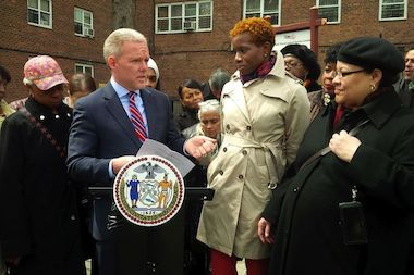 City Councilman Jimmy Van Bramer annouces funding for a new lighting system at the NYCHA Ravenswood Houses in Queens.