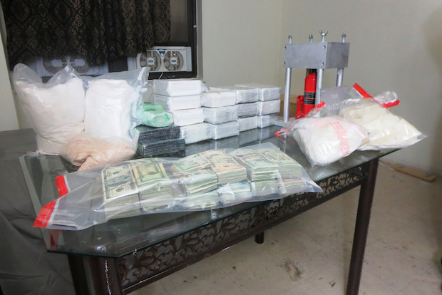 Officials found 44 pounds of heroin and 17 pounds of crystal meth hidden at 111 Wadsworth Ave. Monday.