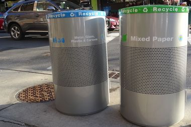 New recycling bins have been placed along Austin Street in Forest Hills.