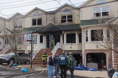 A fire erupted at 106 Pitney Ave. Friday morning, damaging four homes and injuring seven people, the FDNY said.