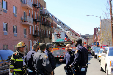 An NYPD sergeant and a police officer were hospitalized with minor smoke inhalation after a large fire broke out in a four-story apartment building in Williamsburg.