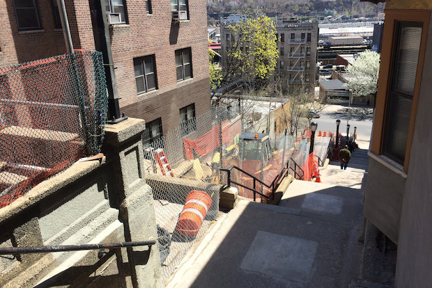 The $2.5 million project was delayed after workers discovered gaps under the stairwell handrails.