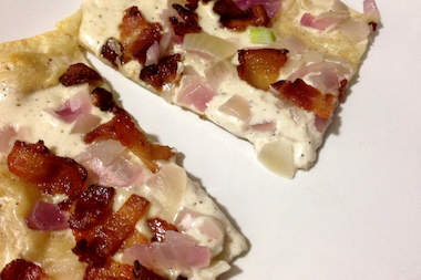 La Cigogne, a new restaurant at 215 Union St., is serving traditional French cuisine from Alsace, including tarte flambée, a thin flatbread-like dish with creme fraiche, onions and thin sliced crispy bacon.