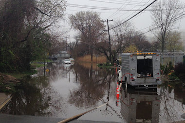 Two cars were trapped in a large pond of water at 71st Street and 149th Avenue after rains and tidal currents flooded the area Wednesday April 30, 2014.
