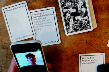 A pair of  design students invented a card game that keeps people from being anti-social with the smartphones by turning their devices into the life of the party.