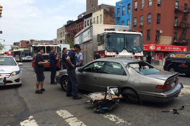 Two people were injured in a collision with a fire truck in East Harlem