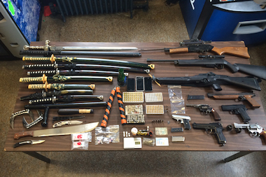 Police found guns, swords, a machete and drugs after searching 175 Dahill Road in Brooklyn on May 15.