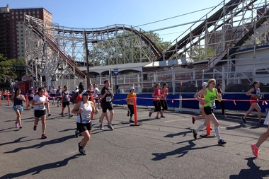 A 31-year-old runner died after collapsing at the finish line of the Brooklyn Half Marathon Saturday morning, race officials announced. This photo was taken at the Brooklyn Half Marathon finish line on the Coney Island boardwalk in 2012.