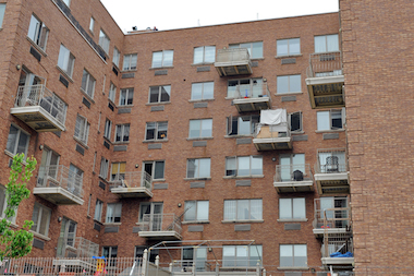 The 21-month-old boy fell from a sixth-floor window and landed on a third-floor balcony, police said.