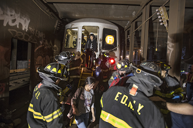 Passengers were evacuated from an F train that derailed in Woodside, Queens on May 2, 2014.