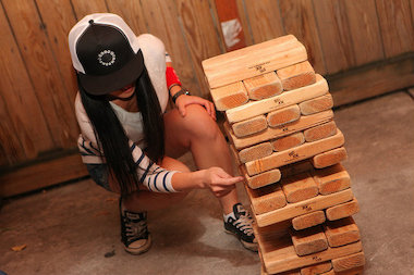 A woman plays giant Jenga at a party for Yelp. The company will bring a set to the third annual DayLife festival in the Lower East Side June 1, 2014.