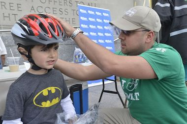A boy was fitted for a free helmet at the Brooklyn Public Library in 2013.