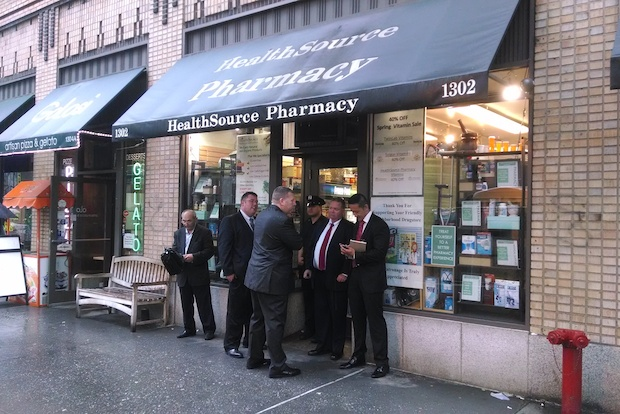 Police fatally shot a man who pulled out a 9 mm at them near the FDR after allegedly robbing the Health Source Pharmacy Friday for the fifth time in the past four years.