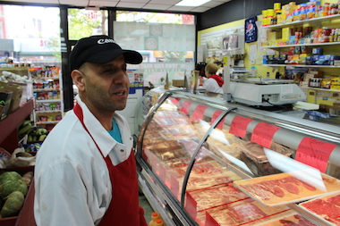 Domingo Fernandez, owner of Midtown Fish & Meat Market on E. 116th Street.