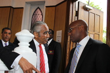 Incumbent Rep. Charles Rangel (C) chats with opponent Rev. Michael Walrond (R) in the foyer of St. Luke's A.M.E. Church on Amsterdam Avenue as another opponent, state Sen. Adriano Espaillat (L), looks on. Mayor Bill de Blasio said he will not endorse a candidate in the tight June 24 Democratic primary for the 13th congressional district race.