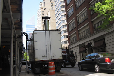 Residents of the enclave are angry at a building's temporary boiler parked outside for three years.