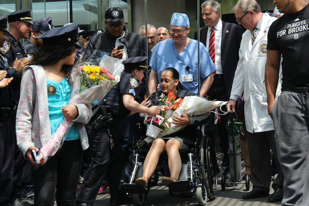 Officer Rosa Rodriguez has been hospitalized since April, when she responded to a fire in Coney Island.