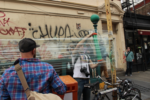 Two students are inviting graffiti artists to draw on walls of plastic wrap in random spots in Brooklyn.