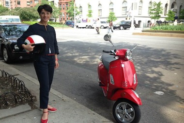 Lucia Pasqualini, deputy consul general of Italy, poses with the top prize — a Vespa S150.