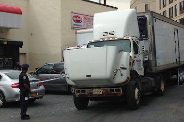 A man was killed when a tractor-trailer hit him in Forest Hills Wednesday morning, a witness said.