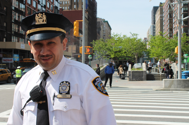 24th Precinct Capt. Marlon Larin stands in front of the intersection of West 96th Street and Broadway, which was redesigned by the DOT after fatal crashes happened there.